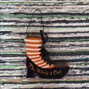 Halloween witches boot door sign witch is out in